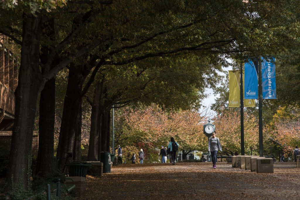 Students walking on the Fairfax Campus in Fall. Photo by Evan Cantwell/Creative Services/George Mason University